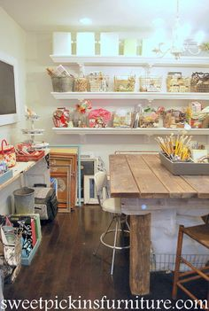 "some good ideas here for using the ""clutter"" of a craft room as the decoration. simple and still beautiful"