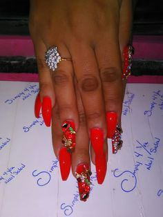 Solid red base with lips, cherries, lipstick, Eiffel tower accessories on 3 finger's an 1 Thumb on a Coffin nail set.
