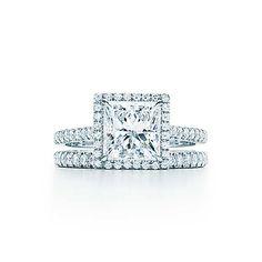 Tiffany Soleste® Princess Cut Engagement Rings   Tiffany & Co. Bead-set diamonds surround a princess-cut diamond in this elegant platinum design.