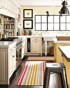 Suzie: Greg Scheidmann  bright, sunny kitchen design with ivory cabinets, white carrara marble ...