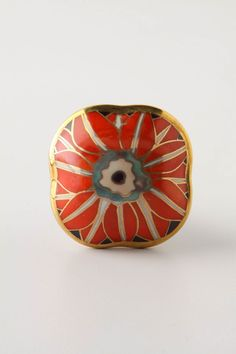 Accessorize with tangerine shades through unconventional pieces like knobs.