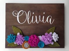 This gorgeous rustic wooden sign with felt floral detail would make a beautiful addition to a hunting in a baby girls nursery or for a girls room decor, and makes a thoughtful and unique baby shower/birthday gift! All flowers are handmade and assembled. Each sign is made to order and made with lots of love! The sign measures 9x11 3/4x 3/4 and is stained in a rich dark walnut and the letters are hand painted in white. Comes ready to hang with a sawtooth hanger on back. ❥ ❥ ❥ Do you want to…