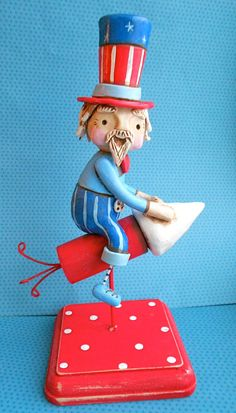 Uncle Sam on a Firecracker - clay folk art. $75.00, via Etsy.