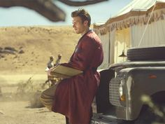 Taylor Swift Fulfills Our Wildest (Fashion) Dreams in Her New Music Video | THE HUGH HEFNER ROBE  | Taylor's hot costar, Scott Eastwood, makes a silky pajama topper look really, really good, in case you were wondering.