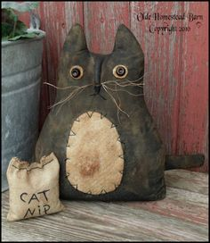 "this primitive kitty would be a purrrrfect bowl filler with some little white ""boo"" pumpkins"