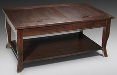 Cocktail table has two removable insets that reveal secret storage space. Has matching end table.  Leons