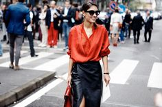 MILAN FASHION WEEK A red blouse with a sexy split leather skirt grabbed attention for all the right reasons. Perfectly paired with a pair of cat eyes.