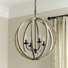 The Hudson 4-Light Pendant features a rustic weathered oak wood in a modern orb pendant design.