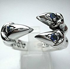 With this blue sapphire sterling silver Gothic claw ring admire looks are guaranteed. Inspired by dragons and made to chill by our expert silversmiths. Sapphire Stone, Blue Sapphire Rings, Blue Rings, Sterling Silver Mens Rings, Sterling Silver Cross, Mens Band Rings, Rings For Men, Silver Skull Ring, Skull Rings