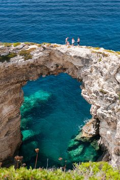 Oooh. If it the water is deep enough, I'd love to jump off that bridge! Triptos Arch, Kerkyra, Nisia Ionioy, Greece.