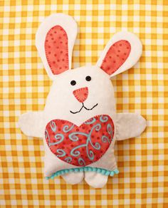 """Little Love Bunny wears his appliqué heart on his tummy, showing everyone how much he cares. Easy to sew and a great beginner project. Little Love Bunny is 9"""" tall including his ears. Skill - Beginner"""