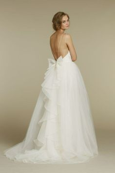 Tulle wedding dress with bow. Love the bow just not so much tulle.