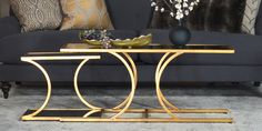 The Leighton nesting tables add instant glitz to spaces in need of a little opulence with gold detailing and mirrored tops. Shop online now. #LivingSpaces