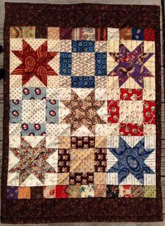 Lori at  Humble Quilts  organized a Doll Quilt exchange and I am the fortunate recipient of Sandy Helin's adorable piece. Sandy blogs a...