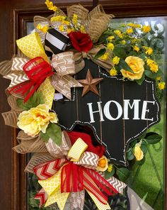 Yellow rose of Texas floral wreath accented in red/yellow with black and white home sign in the shape of Texas.