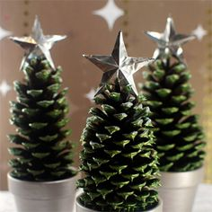 Easy Christmas trees made with dollar store pots and scavenged pine cones. Easy and cute!
