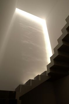 Indirect light entering the staircase inside the Ozuluama Residence by Architects Collective and  At103.