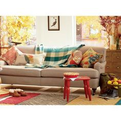 mixing patterns and colors to add interest to a neutral couch