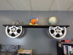 A simple auto decor themed shelf made out of wheels. While not tire repurposing, it's still in the car and tire scheme!