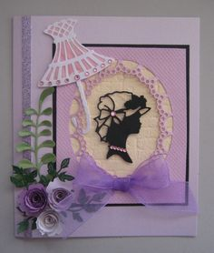 Lady & Parasol Card.  Made using the Marianne Creatables Elegant Lady; Marianne Craftables Roses Basket and the flowers, Die-Namic Royal & Mini rolled roses. The frame is Marianne Craftables Passe-Part Out die.