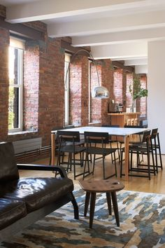 In this loft in New York's Chinatown neighborhood, steel-framed chairs in stark black work well with a white marble table thanks to the warm wood accents that connect both pieces | archdigest.com