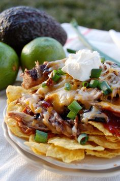 Porky BBQ Nachos! I love fusion recipes! Mmmm! Top the juicy pork w/ cheese, avocado, green onions and of course lots of BBQ sauce! Crunchy, salty...all around yummy!