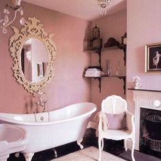 Romantic, classic bathroom - love the fireplace in the bath