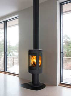 Bilderesultat for peis stålpipe Stove, Home Appliances, Wood, House Appliances, Range, Woodwind Instrument, Timber Wood, Appliances, Trees