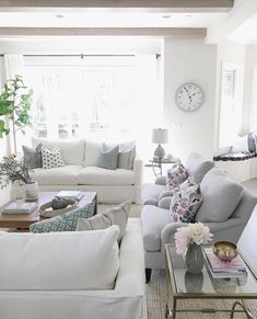 Bright and light with just a touch of English Garden. Love spotting our playful floral pillows in @lifeoncedarlane's gorgeous living room! #RugsInLivingRoom #livingroom