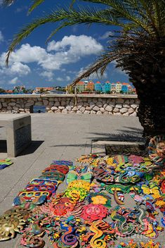 Artwork At Street Market In Curaçao is as colorful as the Buildings in the background.