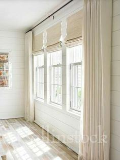 curtains hung way above window and blinds inside mount