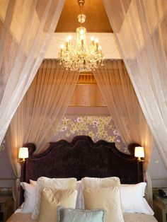 St Regis Hotel, Singapore. #bedroom #hotelroom #bed #lighting #design #oriental #lamps #chandelier #crystal #pillows