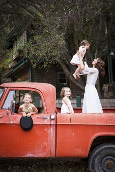 Country - Ruthie Sommers with her three daughters in a vintage pickup truck