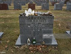 The gravestone of jazz singer and songwriter Billie Holiday is viewed March 25, 2015 at Saint Raymond's Cemetery in New York. Billie Holiday died with just $50 to her name taped to her thigh, but on the 100th anniversary of her birth the jazz legend is enjoying a renaissance as a trailblazer for generations of singers. Holiday was broken down by heroin use, police harassment and a husband who would beat her so severely she would tape her ribs before concerts. But ahead of the centennial of…