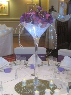Purple orchids in martini glass