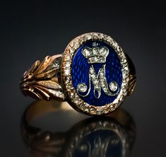 An exceptionally rare Russian Imperial Presentation gold ring of museum quality, with a diamond cipher of Empress Maria Feodorovna, consort of Emperor Paul I (ruled 1796-1801). The cipher is set with rose-cut diamonds and placed on a royal blue guilloche enamel shield with a rose diamond border.
