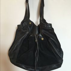 Lucky Brand leather purse 100% leather Lucky Brand purse.  Drawstring in front for a loose or tight, look.  Big suede pocket in front.  Excellent condition.  A perfect go to purse. Lucky Brand Bags Shoulder Bags