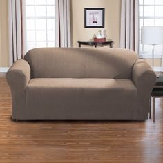 @Overstock - Dimples One Piece Stretch Sofa Slipcover - Sophisticated and stylish, this sofa slipcover offers protection of your furniture in a busy home. This slipcover is available in a variety of colors to better complement your decor.  http://www.overstock.com/Home-Garden/Dimples-One-Piece-Stretch-Sofa-Slipcover/9721778/product.html?CID=214117 $87.99