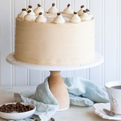Caramel Cappuccino Cake - espresso cake paired with caramel buttercream frosting, topped with whole coffee beans and a sprinkle of cocoa powder.
