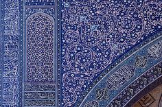 Image IRA 0708 featuring decorated area from the Masjid-i-Jami, in Isfahan, Iran, showing Geometric PatternFloriated Arabesque and Calligraphy using ceramic tiles, mosaic or pottery.