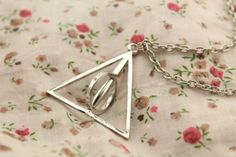 harry potter jewelry the Deathly Hallows can spin by tamaraflying, $1.80