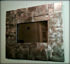 Staggered Steel Shim Mirror by AnthroPhilanthropy on Etsy, $160.00