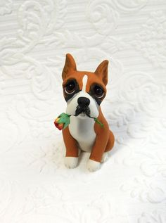 Boxer lover Gift, Boxer art, Boxer Sculpture Polymer Clay with Rose Mini by Raquel at theWRC clay DOG Collectible. Boxer lover Gift, Boxer art, Boxer Sculpture Polymer Clay with Rose Mini by Raquel at theWRC clay DOG Collectible This little pup looks so cute holding a a rose in it's mouth for someone special! Hand sculpted polymer clay dog. Made with love and care! Measures approx. 2.75 inches tall.