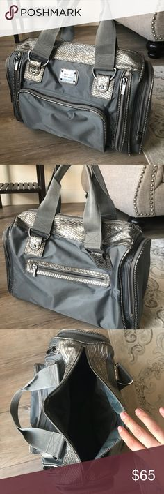 Armani Exchange Gym Travel Handbag Bag Silver Gorgeous Armani Exchange handbag. I used it for the gym as it's a great size and there's many compartments to store your things! It's been well loved as you can see by the pics, but there's plenty life in it yet!  Any questions please ask A/X Armani Exchange Bags Travel Bags