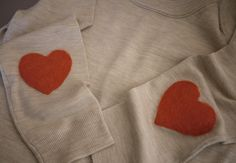 DIY needle felted elbow patches.  it's cute, but I'm still warming up to regular elbow patches being a big trend as is..