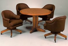 Custom dining set with swivel tilt caster club chairs made by I.M. David. The chairs adjust in height and tension of the tilt. The table is available in laminate or solid wood and different sizes and shapes. Available at www.discountdinettes.com
