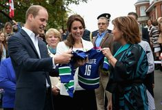 Prince William Photos Photos - Catherine, Duchess of Cambridge and Prince William Duke of Cambridge is presented with personalised sports shirts for Prince George and Princess Charlotte by BC Governor Christy Clark at Cridge Centre for the Family on the final day of their Royal Tour of Canada on October 1, 2016 in Victoria, Canada. The Royal couple along with their Children Prince George of Cambridge and Princess Charlotte are visiting Canada as part of an eight day visit to the country…