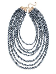 simple shiny beads, done up in a lush multi-strand look for a stunningly dramatic and extravagant vibe.