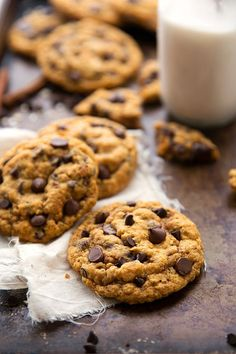 """A delicious and simple-to-make pumpkin oatmeal chocolate-chip cookie that is crisp on the outsides and chewy in the center. These oatmeal cookies are not """"cakey"""".I know a lot of you know and love the traditional oatmeal pumpkin cookie! This, is not quite that recipe. It's not even a little bit """"cakey,"""" but rather crisp on..."""