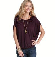 Back Zip Notched Sleeve Wedge Tee - With glam volume to spare, this drapey wedge tee gets dramatic with a back zip and beautifully notched sleeves. Jewel neck. Short notched sleeves. Gathered beneath banded neckline. Grosgrain trimmed back zipper with pull. Gathered elasticized hem.